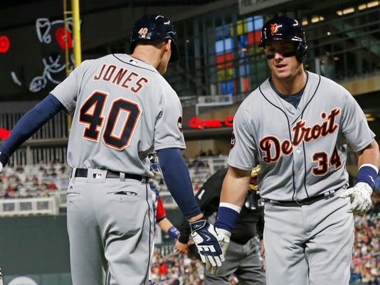 Detroit Tigers' James McCann, right, is contratulated by JaCoby Jones on his solo home run off Minnesota Twins pitcher Hector Santiago during the sixth inning of a baseball game Friday, April 21, 2017, in Minneapolis. (AP Photo/Jim Mone)