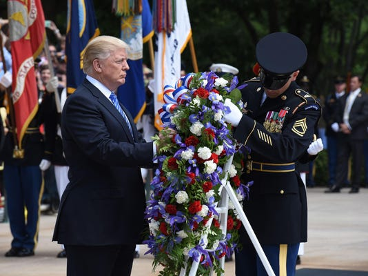 President Donald Trump speaks at a wreath-laying ceremony in Arlington Cemetery - Virginia