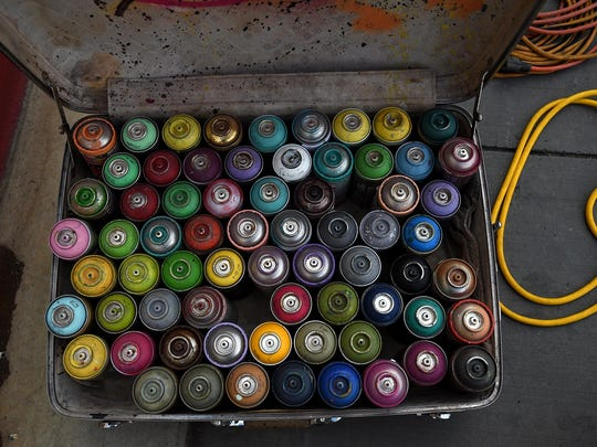 A collection of spray paint bottles is seen during the Circus Circus 24-Hour Mural Marathon in downtown Reno in 2015.