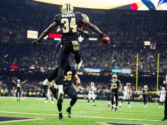 Saints Defensive back Justin Hardee scores a touchdown after blocking a punt by Buccaneers kicker Bryan Anger as The New Orleans Saints take on The Tampa Bay Buccaneers in an NFL football game Sunday, Nov. 5, 2017 in Lafayette, La. (Scott Clause/The Daily Advertiser via AP)