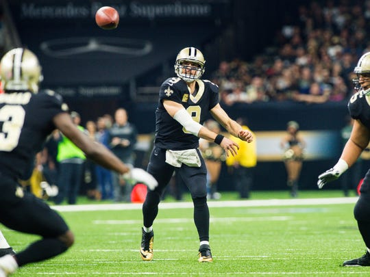 Saints quarterback Drew Brees throws a pass to wide receiver Michael Thomas as The New Orleans Saints take on The Tampa Bay Buccaneers in an NFL football game Sunday, Nov. 5, 2017 in Lafayette, La. (Scott Clause/The Daily Advertiser via AP)