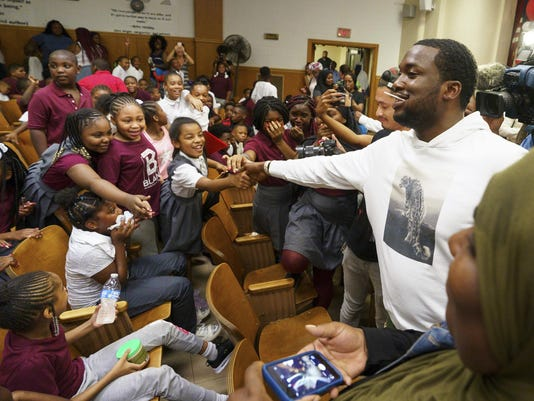Meek Mill donates 6,000 backpacks to Philly school kids at his alma mater