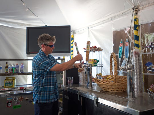 Owner Brad Modesitt pours beer at Paddler's Pub.