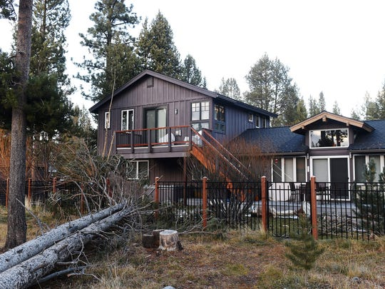 Fallen trees are seen behind a house on Rancho Circle where the body of Dejon Smith was found in South Lake Tahoe on Dec. 16, 2014.