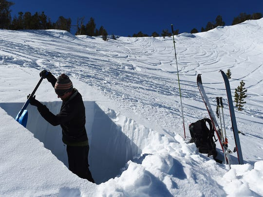 Owner of the Tahoe Mountain School and official observer for the Sierra Avalanche Center Steve Reynaud digs a snow pit on a northeast slope of Mount Tamarack near the top of Mt. Rose Highway south of Reno on Feb. 24, 2015.