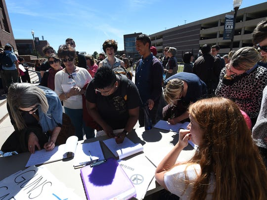 "People sign petitions following a planned protest against the ""campus carry"" bill at the University of Nevada in Reno on March 25, 2015."