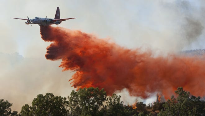 Firefighters combat a wildfire in Diamond Valley Saturday, Aug. 6, 2011.