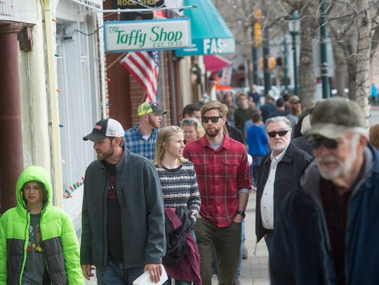 People wander the row of shops on Elkhorn Avenue in Estes Park. A group of citizens has submitted petitions to recall the mayor and mayor pro-tem.