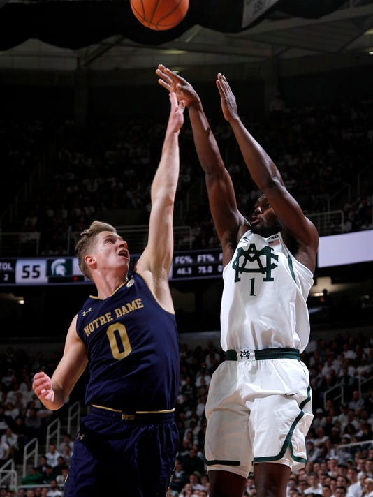 Michigan State's Joshua Langford, right, shoots against Notre Dame's Rex Pflueger (0) during the second half of an NCAA college basketball game, Thursday, Nov. 30, 2017, in East Lansing, Mich. Michigan State won 81-63. (AP Photo/Al Goldis)