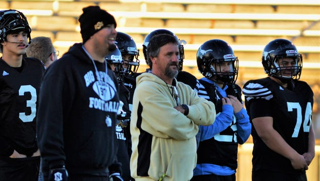 Big Spring coach Mitch McLemore (center) conducts practice last season, when the Steers did not win a game.