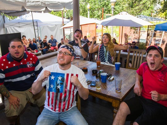 Graeme Doyle (center) and his friends Mick Maloney (L-R), Sean Lowery, Kim Gunn and Sean Thomson react to the USA v. Germany game at Rose and Crown in Phoenix, AZ on Thursday, June 26, 2014.