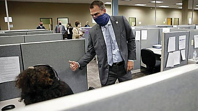 Gov. Kevin Stitt gives a thumbs up to a call center worker as he tours a new Oklahoma State Department of Health COVID-19 contact tracing center inside the old Shepherd Mall in Oklahoma City on Aug. 5. Bryan Terry/The Oklahoman