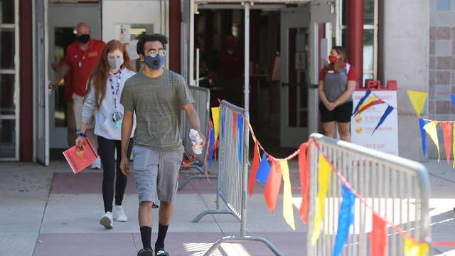 Iowa State University students come out from the Lied Athletic Recreation Center after testing COVID-19 before they move-in their dorms in Ames. File photo by Nirmalendu Majumdar/Ames Tribune