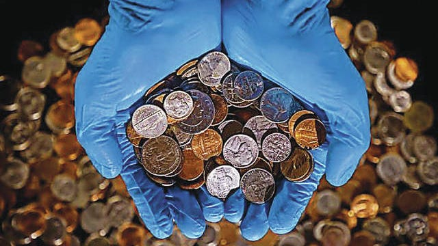 At least one Oklahoma bank is asking its customers to conserve change as it and other financial institutions deal with a national supply problem for coins. Chris Landsberger/The Oklahoman