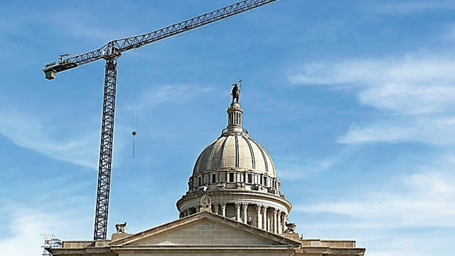 A crane above the dome of the state Capitol on Tuesday, Jan. 8, 2019, as an extensive restoration project continues on the interior and exterior of the building. Jim Beckel/The Oklahoman