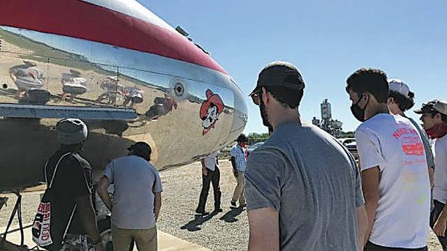 Interns with the Oklahoma State University Unmanned Systems Research Institute inspect an aircraft. USRI partnered with Navatek to fund the internship program, which allows the high school students to work in USRI's lab. Courtesy