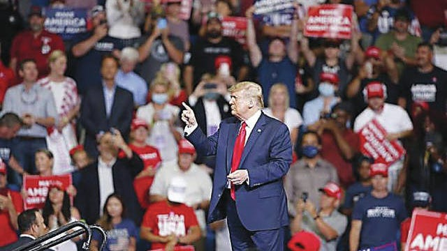 President Donald Trump points to the crowd Saturday during a rally at the BOK Center in Tulsa. Sarah Phipps/The Oklahoman