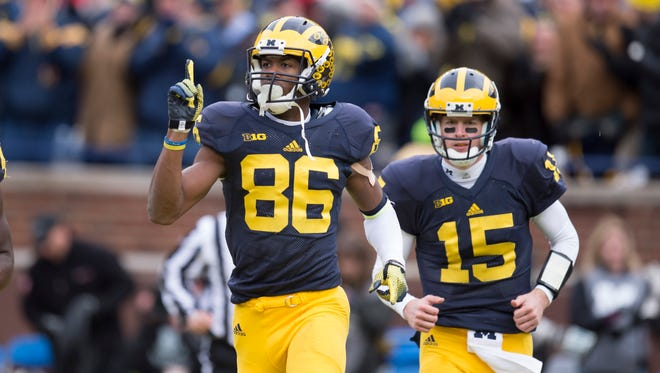 Michigan wide receiver Jehu Chesson celebrates after scoring a touchdown in the first quarter.