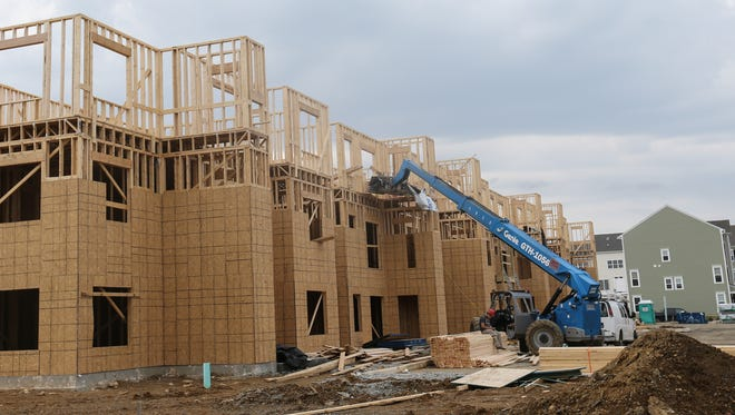 Crews work on the next phase of The Reserve at Darley Green, a rental community in Claymont, on Wednesday. The popularity of rentals with young residents is driving demand, real estate observers say.