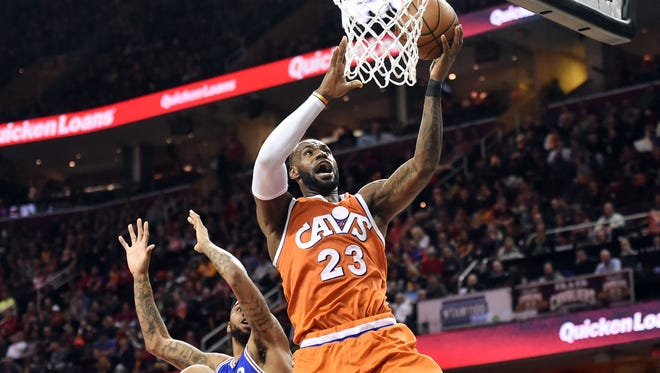 Cleveland Cavaliers forward LeBron James (23) drives to the basket against against the Philadelphia 76ers during the second half at Quicken Loans Arena.