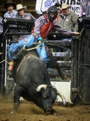 Roscoe Jarboe rides a bull during the 10th performance