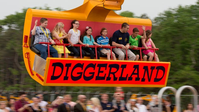 Guest ride in a modified excavator bucket during a preview day at Diggerland USA Thursday, May 22, 2014, in West Berlin, N.J.  The theme park is said to be the first theme park of its kind in the U.S., though many of its plans are based on similar parks in the United Kingdom.
