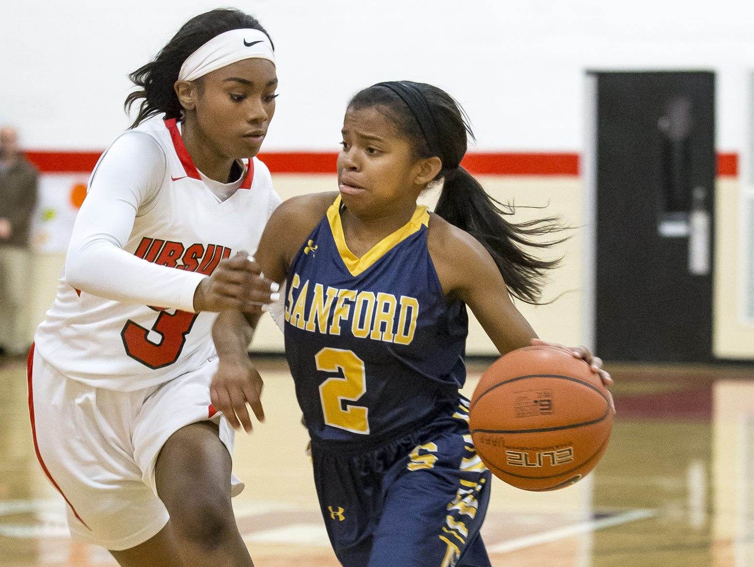 Sanford's Lauren Park (right) drives against Ursuline's Yanni Hendley-McCalla during Ursuline's 50-40 win on Feb. 16.