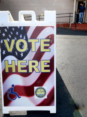 Peolple leave the Middle Tennessee Association of Realtors, one of the 7 early voting sites in Rutherford County, on the last day of early voting, Thursday, Nov. 3, 2016.