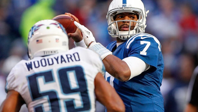 Indianapolis Colts quarterback Jacoby Brissett (7) looks to pass over Tennessee Titans inside linebacker Wesley Woodyard (59) in the first half of their game at Lucas Oil Stadium Sunday, Nov. 26, 2017.