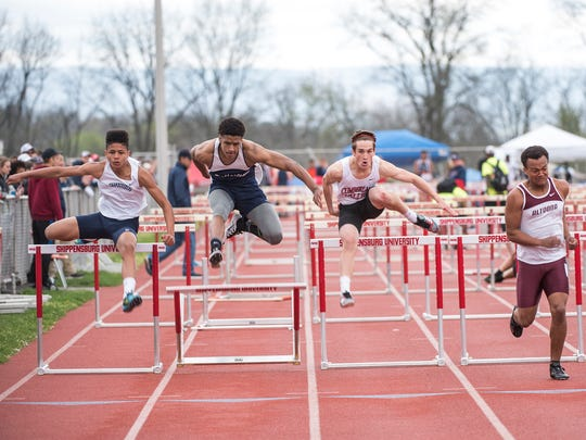 Dallastown's Jawaun McMillian, second from left, finished 22nd in the 110 hurdles during the Shippensburg University High School Track and Field Invitational on Saturday, April 23, 2016.