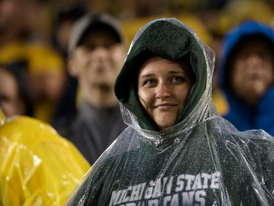 A Michigan State fan watches the action during the