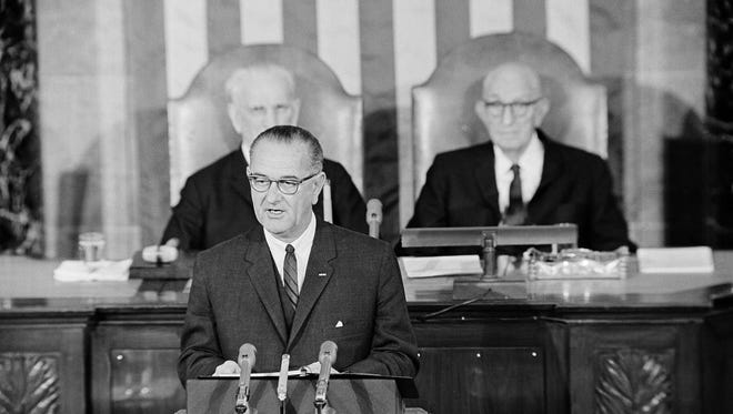 """President Lyndon B. Johnson announced a surprise budget cut in his State of the Union message Jan. 8, 1964. He said his budget would be """"efficient, honest and frugal."""""""
