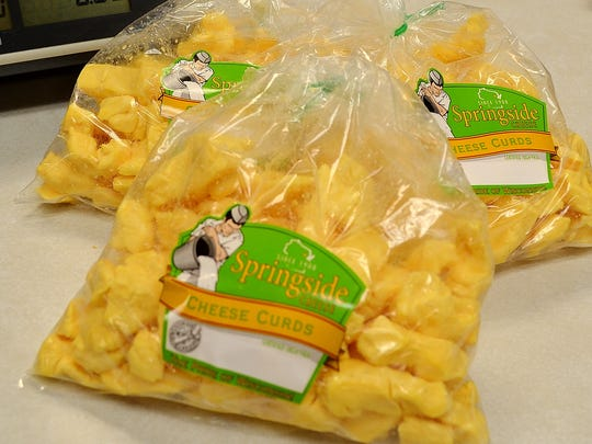 Golden fresh cheese curds ready for purchase by the scale at Springside Cheese north of Oconto Falls.