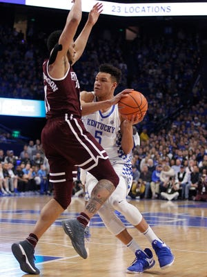 Jan 23, 2018; Lexington, KY, USA; Kentucky Wildcats forward Kevin Knox (5) takes the ball to the basket against Mississippi State Bulldogs guard Quinndary Weatherspoon (11) in the first half at Rupp Arena. Mandatory Credit: Mark Zerof-USA TODAY Sports
