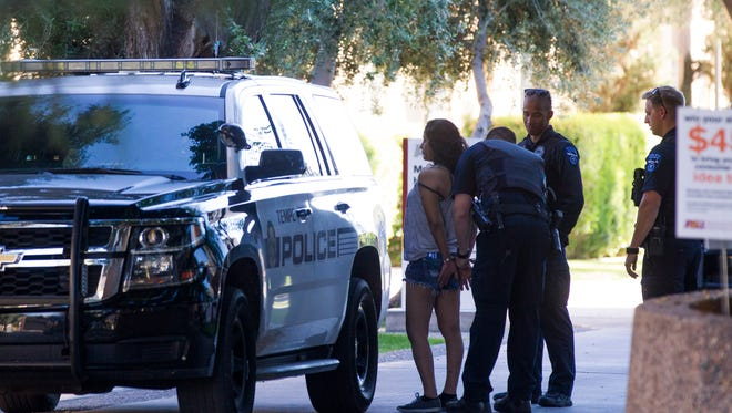 A woman was arrested after she fled a traffic collision on University Drive near Arizona State University's Tempe campus, police said on March 12, 2017.