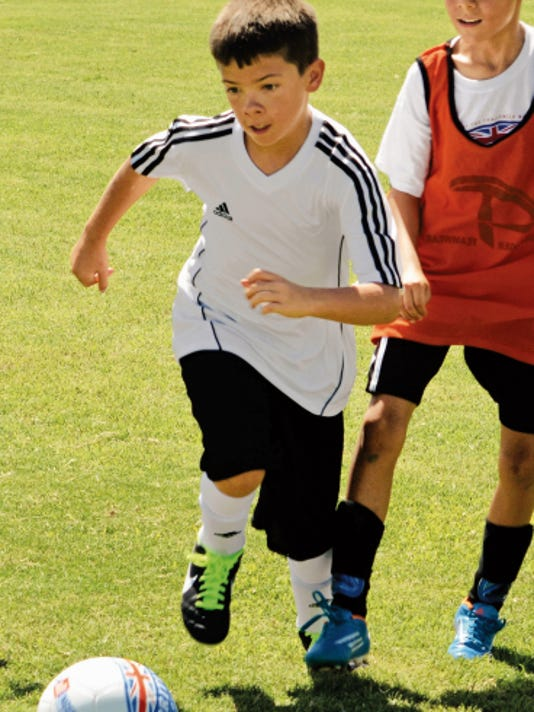 Matt Hollinshead — Current-Argus Ryan Fuller, 11, chases after the ball during a scrimmage at the Challenger Soccer Camp Tuesday at Bob Forrest Youth Sports Complex.