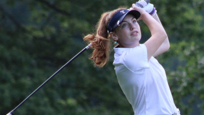 Gia Currey hits a drive during Tallmadge's fourth-place finish at the second of four Suburban League tournaments Wednesday at Brookledge Golf Club in Cuyahoga Falls.