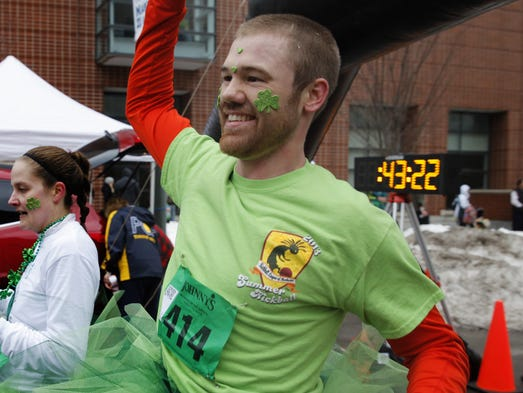 Wayne Evans of Rochester finishes Johnny's Runnin' O the Green with a smile and his tutu on Saturday morning.