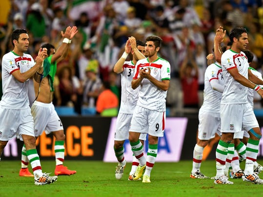 Iranian players applaud the crowd after the group F World Cup soccer match between Iran and Nigeria at the Arena da Baixada in Curitiba, Brazil, Monday, June 16, 2014. The match ended in a 0-0 draw.   (AP Photo/Martin Meissner)