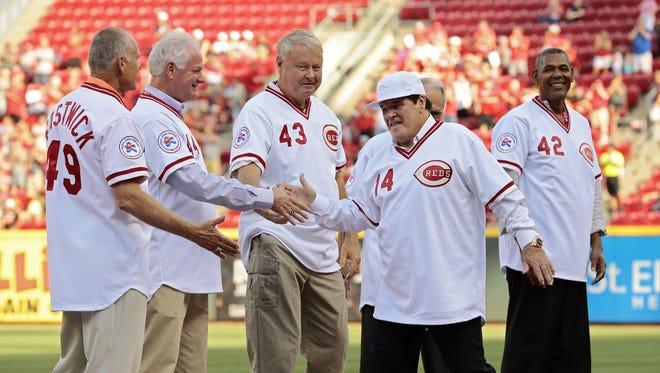 Former Reds great Pete Rose shakes hands with his fellow teammates of the 1976 Big Red Machine Reds team as they are introduced before the MLB National League game between the Cincinnati Reds and the San Diego Padres at Great American Ball Park in downtown Cincinnati on Friday, June 24, 2016.