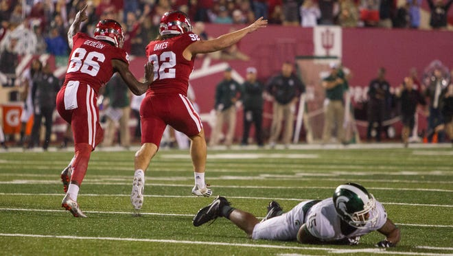 Michigan State's Tyson Smith (15) pounds the turf as Indiana kicker Griffin Oakes (92) celebrates his game-winning field goal in a 24-21 Hoosiers overtime win last Saturday.