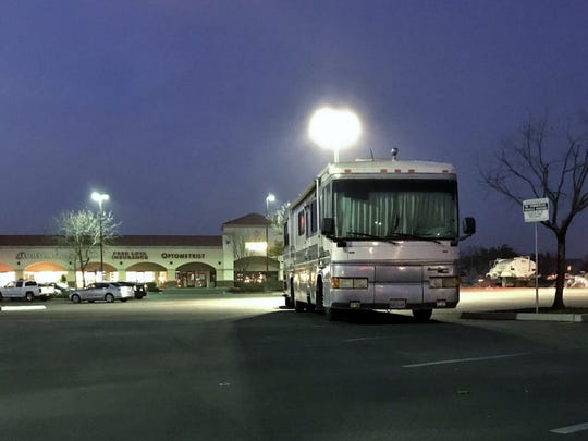 An RV sits in the parking lot near Walmart on Prosperity Avenue in Tulare Thursday evening. The retail store allows vehicles to park in the parking lot overnight.