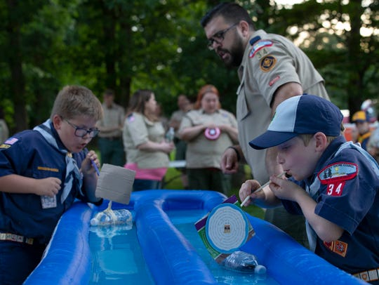 Members of Cub Scouts Pack 34 in Jackson, which is accepting girls as members, compete in the Rainguttter Regatta.