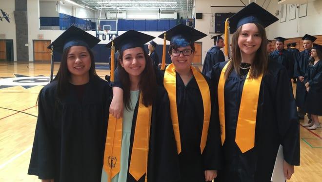 Stissing Mountain grads Frances Vu, Kayla Bowen, Erin Craig and salutatorian Crystal Clancy.