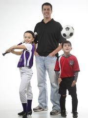This file image shows Rob Lynch, co-founder of Tourney Machine, with his kids Sydney and Ryan on Wednesday, Oct. 30, 2013.