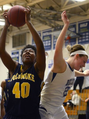 Pocomoke's Dyaisha Christian collides with Decatur's Marina Jones as Christian rebounds the ball Thursday night at Stephen Decatur in Berlin.