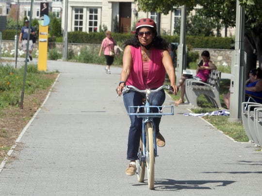 Journal News, Lohud reporter Karen Roberts, rides an electric bicycle in Tarrytown Aug. 9, 2017. Electric bikes, known as eBikes, are powered by pedaling with an assist from a small battery powered motor.