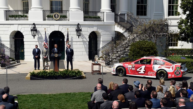 President Barack Obama speaks on the South Lawn of the White House on Tuesday as he stands with Stewart-Haas Racing team Tony Stewart, Kevin Harvick's crew chief Rodney Childers and NASCAR 2014 Sprint Cup Series champ Kevin Harvick.
