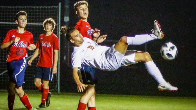 Blackman's Luke Buckley goes airborne during Tuesday's 5-1 win over Franklin County in the 4-AAA semis.