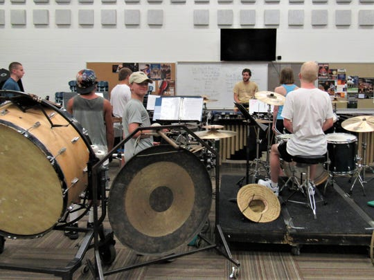 Large instruments make up the front ensemble. Daniel Lenkford, center, has been teaching at the band camp for seven years.